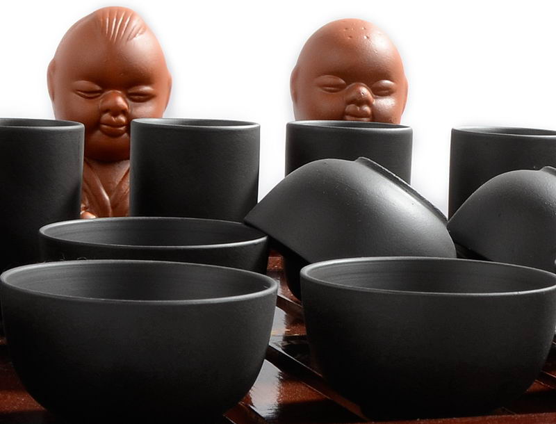 Чёрный набор посуды кунг-фу ча из исинской глины впишется в любую обстановку.
